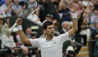 Serbia's Novak Djokovic gestures after winning a point during his men's singles semifinals match against Rafael Nadal of Spain at the Wimbledon Tennis Championships, in London, Saturday July 14, 2018.(AP Photo/Ben Curtis)