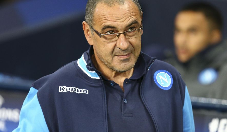 FILE - In this Oct. 17, 2017, file photo, Napoli coach Maurizio Sarri arrives prior to the start of the Champions League group F soccer match between Manchester City and Napoli at the Etihad Stadium in Manchester, England. Chelsea has hired Maurizio Sarri as its manager on a three-year contract. The announcement was made on Saturday, July 14, 2018. (AP Photo/Dave Thompson, File)