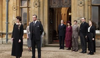 """This undated publicity photo provided by PBS shows, from left, Elizabeth McGovern as Lady Grantham, Hugh Bonneville as Lord Grantham, Dan Stevens as Matthew Crawley, Penelope Wilton as Isobel Crawley, Allen Leech as Tom Branson, Jim Carter as Mr. Carson, and Phyllis Logan as Mrs. Hughes, from the TV series, """"Downton Abbey."""" Focus Features said Friday, July 13, that it will this summer begin production on a """"Downton"""" film that will reunite the Crawley family on the big screen. Series creator Julian Fellowes wrote the screenplay and will produce. (AP Photo/PBS, Carnival Film & Television Limited 2012 for MASTERPIECE, Nick Briggs)"""