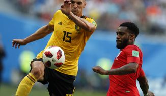 Belgium's Thomas Meunier, left, and England's Danny Rose challenge for the ball during the third place match between England and Belgium at the 2018 soccer World Cup in the St. Petersburg Stadium in St. Petersburg, Russia, Saturday, July 14, 2018. (AP Photo/Natacha Pisarenko)