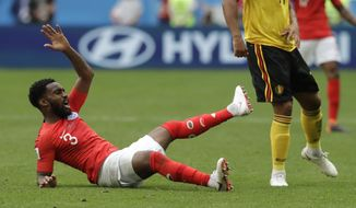 England's Danny Rose takes a tumble during the third place match between England and Belgium at the 2018 soccer World Cup in the St. Petersburg Stadium in St. Petersburg, Russia, Saturday, July 14, 2018. (AP Photo/Petr David Josek)