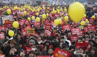 """FILE - In this Dec. 17, 2016 file photo, protesters shout slogans during a rally against the impeached South Korean President Park Geun-hye in downtown Seoul, South Korea. The letters read """"Arrest, Park Geun-hye.""""  South Korean President Moon Jae-in has ordered an investigation after a lawmaker disclosed a document drafted by a military intelligence unit that showed plans to deploy troops in Seoul amid massive protests last year to oust his conservative predecessor, now in prison on corruption charges. (AP Photo/Lee Jin-man, File)"""