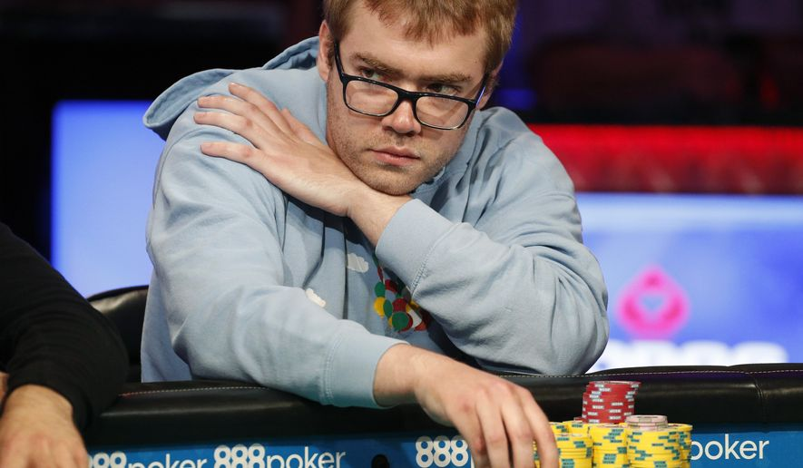 Michael Dyer competes at the final table during the World Series of Poker main event Friday, July 13, 2018, in Las Vegas. (AP Photo/John Locher)