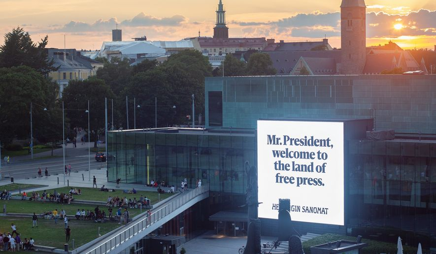 """Helsingin Sanomat, a Helsinki-based newspaper, has placed 300 messages to President Trump and President Putin in the host city, advising """"Welcome to the Land of Free Press,"""" in both English and Russian — on enormous electronic billboards in some cases. (Helsingin Sanomat) (Helsingin Sanomat)"""