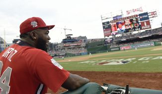World Team Manager David Ortiz watches play in the seventh inning against the U.S. Team during the All-Star Futures baseball game, Sunday, July 15, 2018, at Nationals Park, in Washington. The the 89th MLB baseball All-Star Game will be played Tuesday. (AP Photo/Susan Walsh)