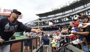 U.S. Team Justus Sheffield, of the New York Yankees, tosses a baseball after signing an autograph for a young fan ahead of the All-Star Futures baseball game, Sunday, July 15, 2018, at Nationals Park, in Washington. The the 89th MLB baseball All-Star Game will be played Tuesday. (AP Photo/Susan Walsh)