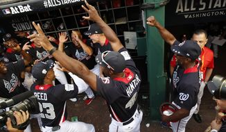 U.S. Team Manager Torii Hunter celebrates with his team after the All-Star Futures baseball game against the World Team , Sunday, July 15, 2018, at Nationals Park, in Washington. The the 89th MLB baseball All-Star Game will be played Tuesday. The U.S. won 10-6. (AP Photo/Alex Brandon)