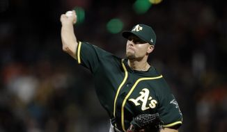 Oakland Athletics relief pitcher Blake Treinen throws to a San Francisco Giants batter during the ninth inning of a baseball game Saturday, July 14, 2018, in San Francisco. (AP Photo/Marcio Jose Sanchez) **FILE**