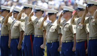 U.S. Marines salute the flag during the singing of the national anthem before a baseball game between the San Diego Padres and the Chicago Cubs in San Diego, Sunday, July 15, 2018. (AP Photo/Alex Gallardo) ** FILE **