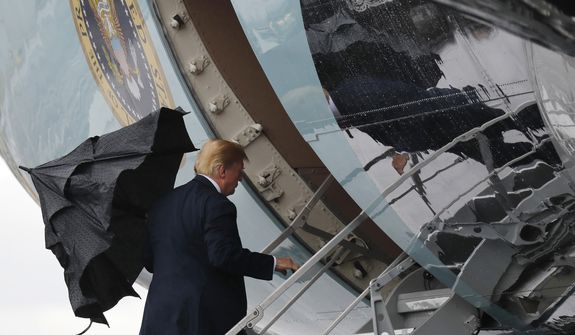 U.S. President Donald Trump boards Air Force One when departing from Glasgow, Scotland, on his way to Helsinki, Finland, Sunday, July 15, 2018 on the eve of his meeting with Russian President Vladimir Putin. (AP Photo/Pablo Martinez Monsivais)