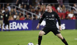 D.C. United forward Wayne Rooney (9) works with the ball during the second half of an MLS soccer match against the Vancouver Whitecaps, at Audi Field, Saturday, July 14, 2018, in Washington. DC United won 3-1. (AP Photo/Alex Brandon) ** FILE **
