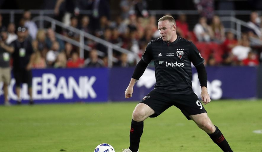 17bc12a2a D.C. United forward Wayne Rooney (9) works with the ball during the second  half
