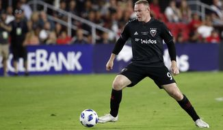 D.C. United forward Wayne Rooney (9) works with the ball during the second half of an MLS soccer match against the Vancouver Whitecaps, at Audi Field, Saturday, July 14, 2018, in Washington. DC United won 3-1. (AP Photo/Alex Brandon)
