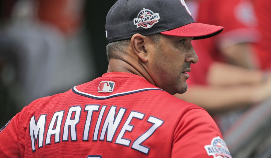 Washington Nationals manager Dave Martinez walks in the dugout before the start of a baseball game against the New York Mets at Citi Field, Sunday, July 15, 2018, in New York. (AP Photo/Seth Wenig)