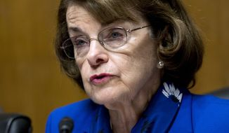 FILE - In this May 16, 2018 file photo Sen. Dianne Feinstein, D-Calif asks questions during a hearing of the Senate Judiciary Committee on Capitol Hill in Washington. The California Democratic Party has snubbed Feinstein by giving its endorsement to her rival, state Sen. Kevin de Leon. He won the party nod Saturday, July 14, 208, after a vote of the party's roughly 360-member executive board made up of local officials and party activists. (AP Photo/Jose Luis Magana, File)