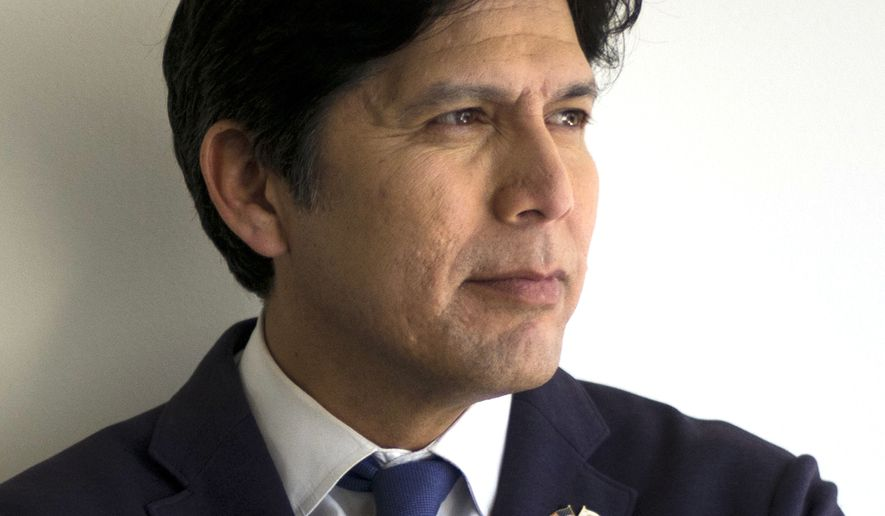 FILE - In this May 3, 2018 file photo, California state Senate President pro Tempore Kevin de Leon, D-Los Angeles, poses for photos in his campaign office in Los Angeles. The California Democratic Party has snubbed U.S. Sen. Dianne Feinstein by giving its endorsement to her rival, de Leon. He won the party nod Saturday, July 14 after a vote of the party's roughly 360-member executive board made up of local officials and party activists.  (AP Photo/Jae C. Hong, File)