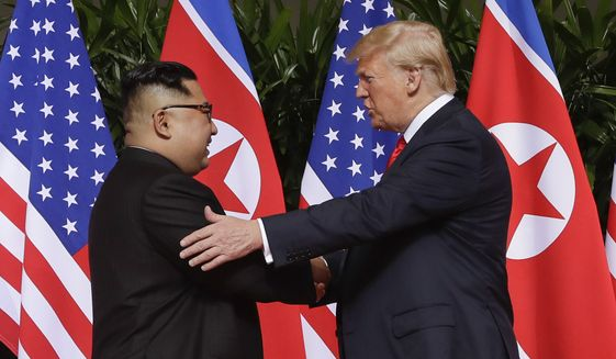In this Tuesday, June 12, 2018, file photo, U.S. President Donald Trump shakes hands with North Korea leader Kim Jong-un at the Capella resort on Sentosa Island in Singapore. (AP Photo/Evan Vucci, File)