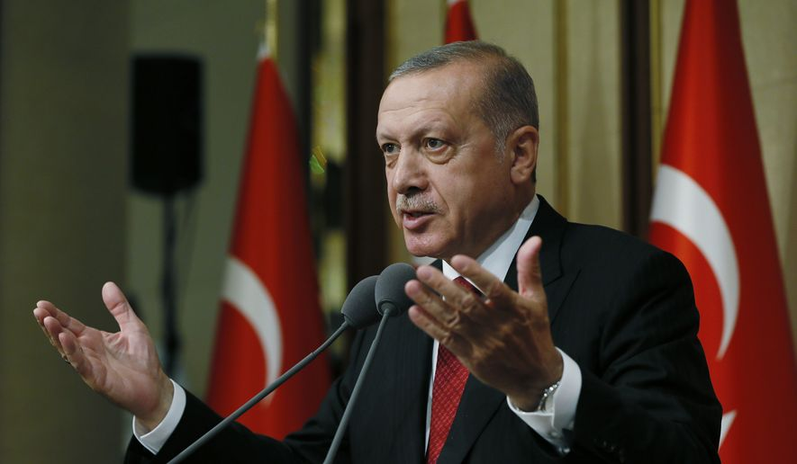 Turkey's President Recep Tayyip Erdogan gestures as he speaks during a commemoration event for the second anniversary of a botched coup attempt, at the Presidential Palace, in Ankara, Turkey, Sunday, July 15, 2018. (Presidency Press Service via AP, Pool)