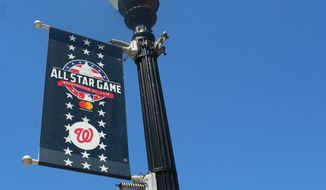 A lamppost banner promotes the 2018 MLB All-Star Game at Nationals Park in Washington, D.C. (Adam Zielonka / The Washington Times)