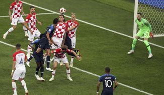 Croatia's Mario Mandzukic, center, deflects the ball into his own goal to open the score during the final match between France and Croatia at the 2018 soccer World Cup in the Luzhniki Stadium in Moscow, Russia, Sunday, July 15, 2018. (AP Photo/Thanassis Stavrakis)
