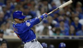 Chicago Cubs' Javier Baez follows through on a two-run double against the San Diego Padres during the fifth inning of a baseball game in San Diego, Saturday, July 14, 2018. (AP Photo/Alex Gallardo)