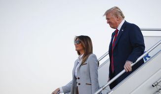 U.S. President Donald Trump and first lady Melania Trump arrive at the airport in Helsinki, Finland, Sunday, July 15, 2018 on the eve of his meeting with Russian President Vladimir Putin. (AP Photo/Pablo Martinez Monsivais)
