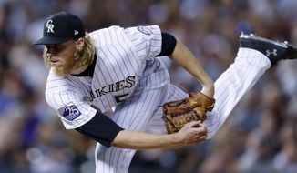Colorado Rockies starter Jon Gray watches a pitch to a Seattle Mariners batter during the eighth inning of a baseball game Saturday, July 14, 2018, in Denver. Colorado won 4-1. (AP Photo/David Zalubowski)