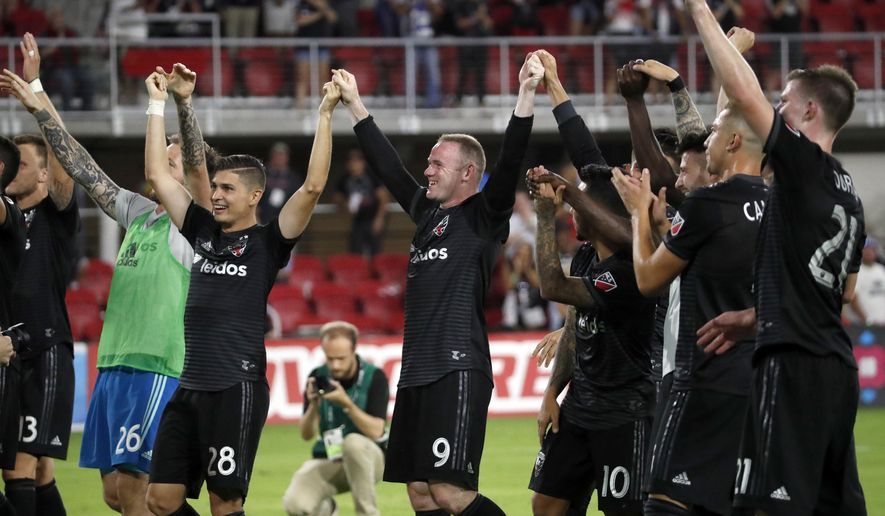 D.C. United forward Wayne Rooney (9) celebrates with teammates after an MLS soccer match against the Vancouver Whitecaps at Audi Field, Saturday, July 14, 2018, in Washington. (AP Photo/Alex Brandon) ** FILE **