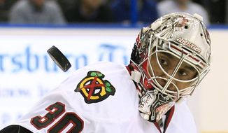 FILE - In this Nov. 4, 2011 file photo Chicago Blackhawks goalie Ray Emery keeps his eyes on a shot by the Tampa Bay Lightning during the second period of an NHL hockey game in Tampa, Fla. Emery has drowned in his hometown of Hamilton, Ontario. He was 35. Hamilton Police confirmed Emery was identified as the victim of the swimming accident Sunday, July 15, 2018. (AP Photo/Chris O'Meara, file) **FILE**