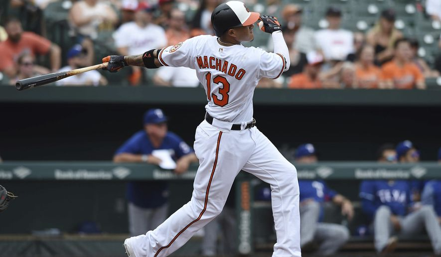 Baltimore Orioles' Manny Machado follows through on a solo home run against the Texas Rangers in the first inning of a baseball game, Sunday, July 15, 2018, in Baltimore. (AP Photo/Gail Burton)