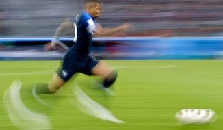 FILE - In this Tuesday, July 10, 2018 file photo France's Kylian Mbappe runs with the ball during the semifinal match between France and Belgium at the 2018 soccer World Cup in the St. Petersburg Stadium, in St. Petersburg, Russia. (AP Photo/Petr David Josek, File)
