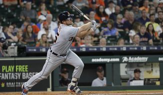 Detroit Tigers' John Hicks hits a two-run home run during the second inning of a baseball game against the Houston Astros Sunday, July 15, 2018, in Houston. (AP Photo/David J. Phillip)