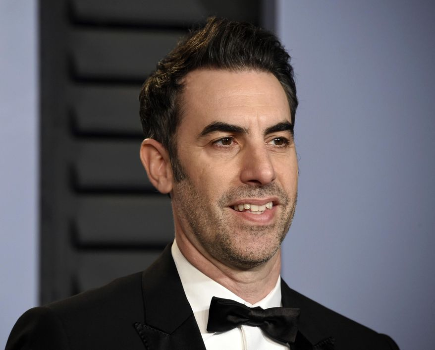 """In this March 4, 2018, file photo, Sacha Baron Cohen arrives at the Vanity Fair Oscar Party in Beverly Hills, Calif. Cohen stars in the new Showtime series """"Who Is America?"""", premiering on Sunday, July 15. (Photo by Evan Agostini/Invision/AP, File)"""