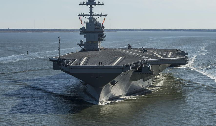 FILE - In this Saturday, April 8, 2017 file photo provided by the U.S. Navy, the USS Gerald R. Ford embarks on the first of its sea trials to test various state-of-the-art systems on its own power for the first time, from Newport News, Va. Naval Sea Systems Command spokesman William Couch said in a statement that the USS Gerald R. Ford arrived Sunday, July 15, 2018, at Newport News Shipbuilding. Work at the shipyard will mark the next phase in the development of the Navy's most advanced and scrutinized warship.  (Mass Communication Specialist 2nd Class Ridge Leoni/U.S. Navy via AP, File)