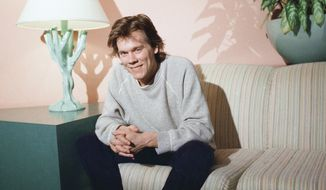 """Kevin Bacon, who burst on the movie scene in the hit movie """"Footloose,"""" sits in the Sunset Marquis Hotel and discusses his effort in the John Hughes movie, """"She's Having a Baby,"""" in Los Angeles, Feb. 12, 1988.  Says Bacon, """"I fought so hard not to be a teen idol. I fought to stay off the magazines and out of the papers."""" Not so anymore, according to the 29-year-old, once-reluctant star. """"I've sort of gained a perspective on that."""" (AP Photo/Ira Mark Gostin)"""
