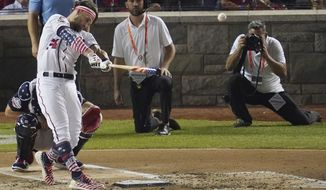 Washington Nationals Bryce Harper (34) hits during the MLB Home Run Derby, at Nationals Park, Monday, July 16, 2018 in Washington. The 89th MLB baseball All-Star Game will be played Tuesday. (AP Photo/Carolyn Kaster)