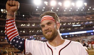 Washington Nationals Bryce Harper celebrates his winning hit after the Major League Baseball Home Run Derby, Monday, July 16, 2018 in Washington.(AP Photo/Patrick Semansky) **FILE**