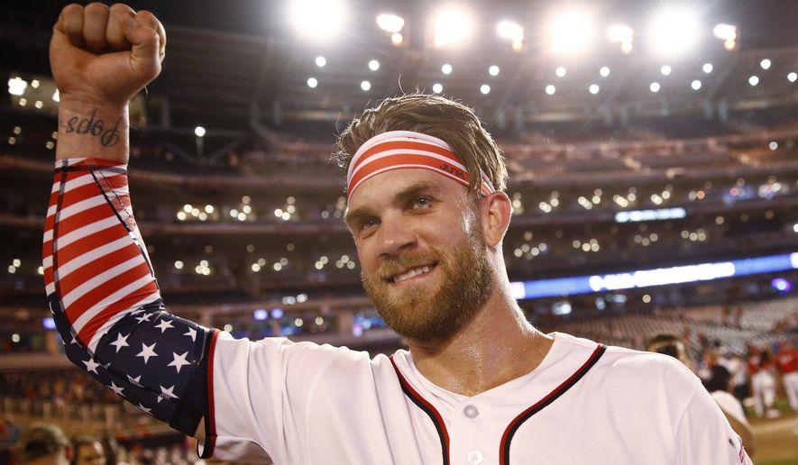 Washington Nationals Bryce Harper celebrates his winning hit after the Major League Baseball Home Run Derby, Monday, July 16, 2018 in Washington.(AP Photo/Patrick Semansky) **FILE**