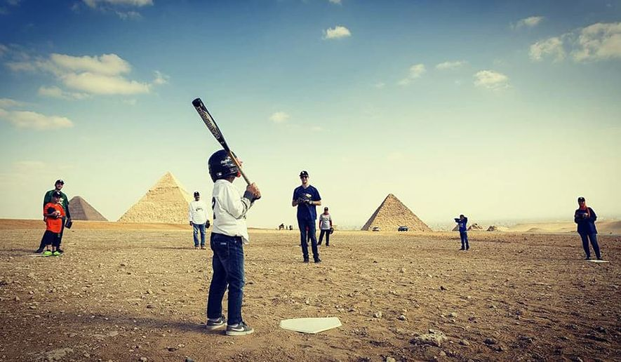 Children and adults playing baseball with iconic Egyptian pyramids in the background. Archaeologists seem to think a form of baseball, America's pastime, existed in Egypt 2,500 year ago. (Photo courtesy of Because Baseball)