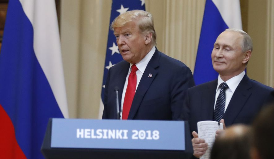U.S. President Donald Trump, left, and Russian President Vladimir Putin arrive for a press conference after the meeting of U.S. President Donald Trump and Russian President Vladimir Putin at the Presidential Palace in Helsinki, Finland, Monday, July 16, 2018. (AP Photo/Alexander Zemlianichenko)
