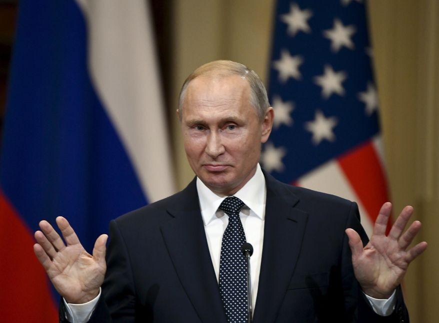 Russian President Vladimir Putin gestures during a joint press conference with U.S. President Donald Trump at the Presidential Palace in Helsinki, Finland, Monday, July 16, 2018. (Antti Aimo-Koivisto/Lehtikuva via AP)