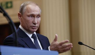 Russian President Vladimir Putin speaks during a press conference after the meeting of U.S. President Donald Trump and Russian President Vladimir Putin at the Presidential Palace in Helsinki, Finland, Monday, July 16, 2018. (AP Photo/Pablo Martinez Monsivais)