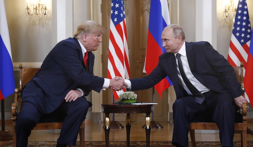U.S. President Donald Trump, left, and Russian President Vladimir Putin shake hand at the beginning of a meeting at the Presidential Palace in Helsinki, Finland, Monday, July 16, 2018. (AP Photo/Pablo Martinez Monsivais)