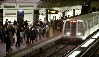 In a Monday, April 5, 2004, file photo, riders wait to board an arriving train at the D.C. Metro Center, in Washington. (AP Photo/Lawrence Jackson, File)