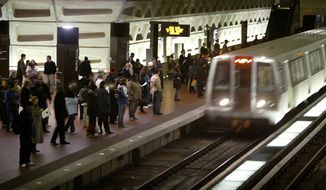 In a Monday, April 5, 2004, file photo, riders wait to board an arriving train at the D.C. Metro Center, in Washington. (AP Photo/Lawrence Jackson, File) **FILE**