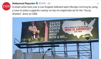 """Showtime star Sacha Baron Cohen is accused of stolen value in a new billboard by the conservative street artist known as """"Sabo."""" The artist covered up a """"Young Sheldon"""" ad to make his point, July 16, 2018. (Image: Twitter, The Hollywood Reporter)"""