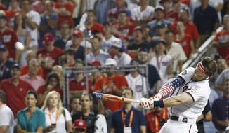 Washington Nationals Bryce Harper hits during the MLB Home Run Derby, at Nationals Park, Monday, July 16, 2018 in Washington. The 89th MLB baseball All-Star Game will be played Tuesday. (AP Photo/Patrick Semansky)