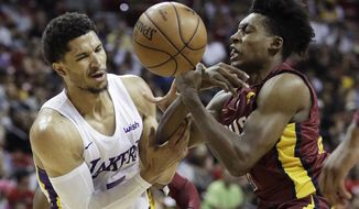 Los Angeles Lakers' Josh Hart, left, and Cleveland Cavaliers' Collin Sexton battle for the ball during the second half of an NBA summer league basketball game, Monday, July 16, 2018, in Las Vegas. (AP Photo/John Locher)