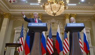 U.S. President Donald Trump, left, tosses a soccer ball to his wife first lady Melania Trump after Russian President Vladimir Putin presented it to him during a press conference after their meeting at the Presidential Palace in Helsinki, Finland, Monday, July 16, 2018. (AP Photo/Pablo Martinez Monsivais)