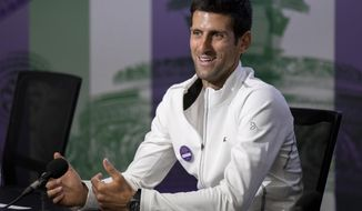 Novak Djokovic of Serbia speaks during a press conference after winning the men's singles final against Kevin Anderson of South Africa at the Wimbledon Tennis Championships in London, Sunday July 15, 2018. (Ben Queenborough/Pool via AP)